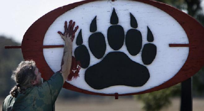Image of protester defacing Blackwater logo (in 2007) from j-walkblog.com