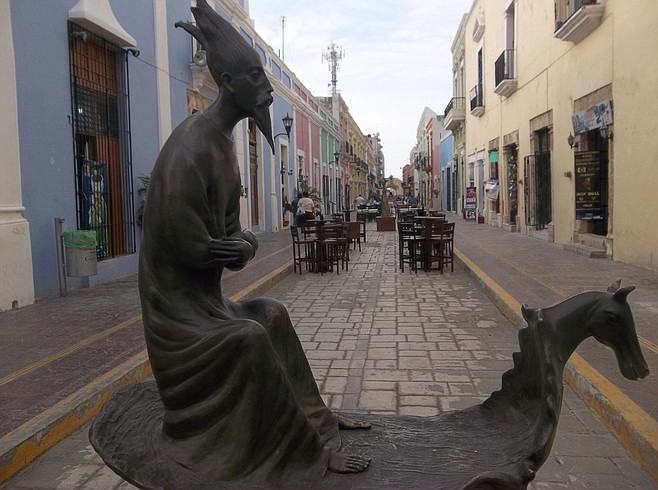 Art and sidewalk cafes in Campeche's colorful old town.