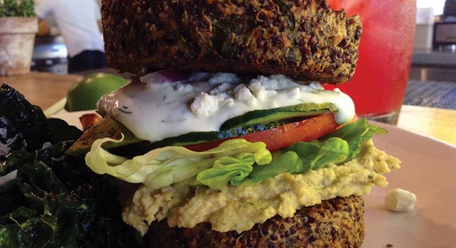 Inside Out Quinoa Burger, with hummus, tzatziki, tomato, cucumber, red onion, avocado, and feta