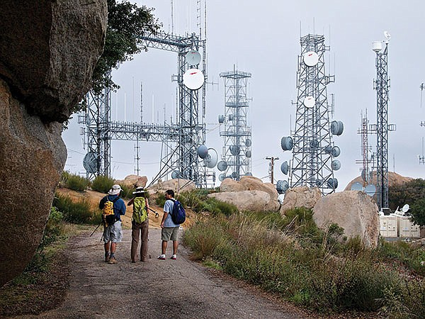 A forest of communication towers is at the summit.