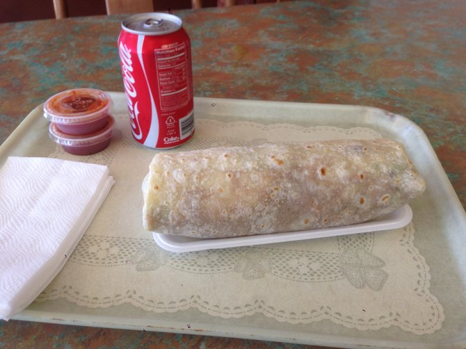 Might look better in a foil wrapper. Chile relleno burrito, add rice and carnitas. Los Reyes.