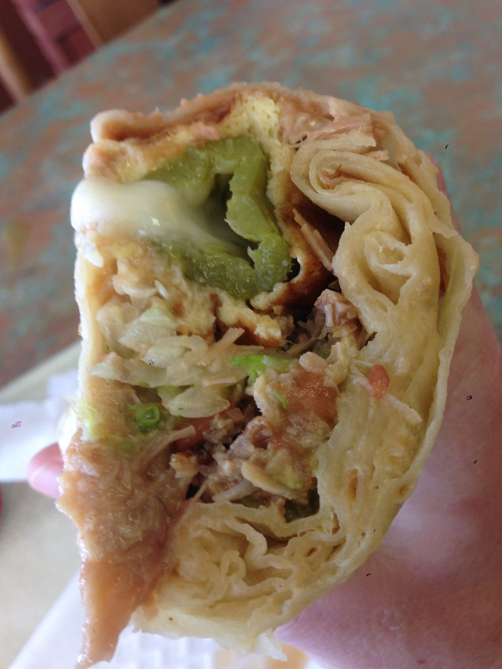 What it looks like before you drown it in salsa. Chile relleno burrito, add rice and carnitas. Los Reyes.