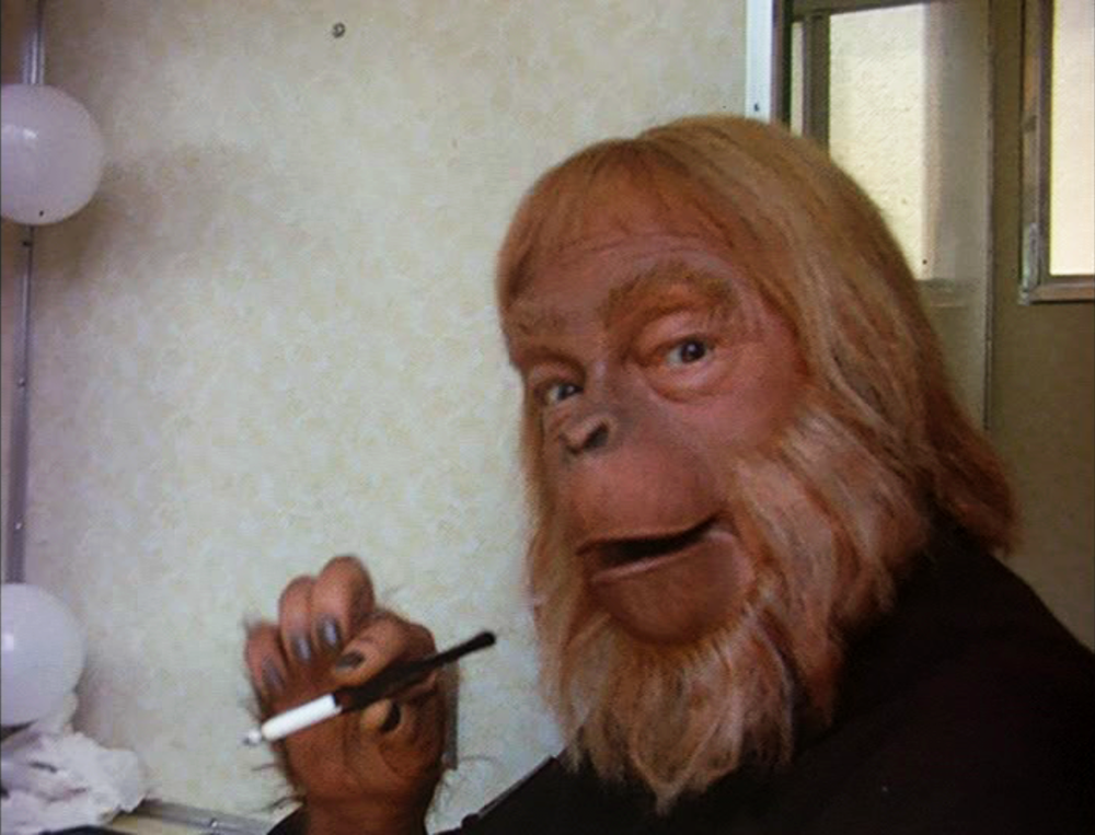"Maurice ""Dr. Zaius"" Evans grabs a butt between takes during the filming of Planet of the Apes."