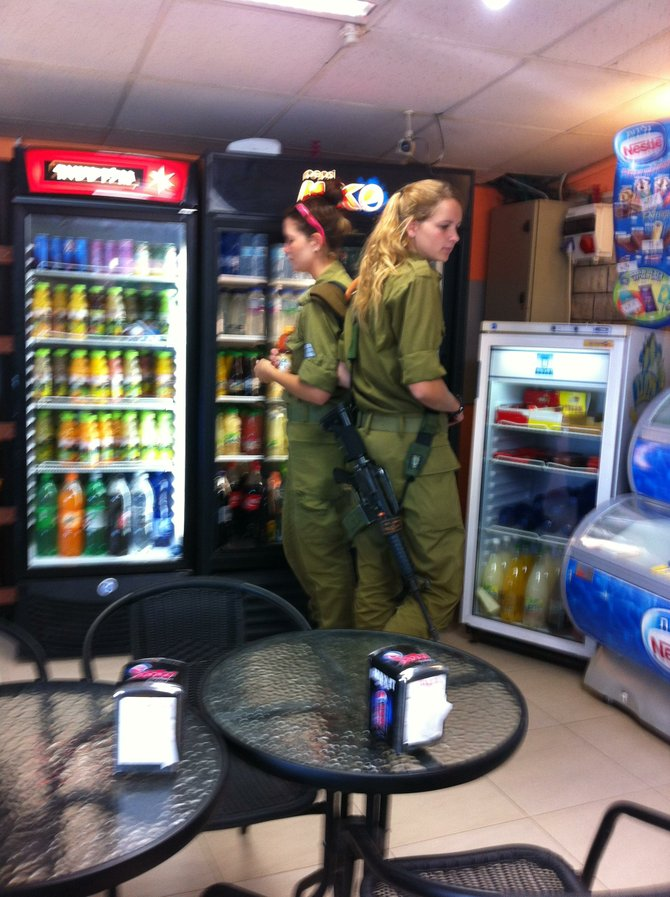 Female soldiers at an Israeli truck stop.