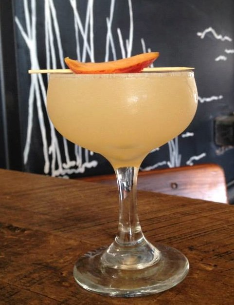 Sessions Public's Peach Please: Muddled peaches, Carpano Bianco, mezcal, lemon, simple syrup