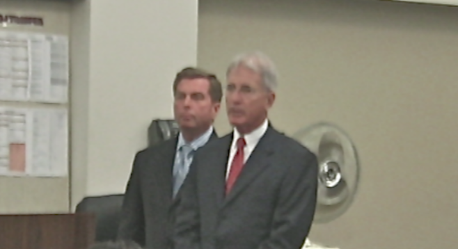 Cartmill (left) with attorney Thomas Warwick on April 24, 2014