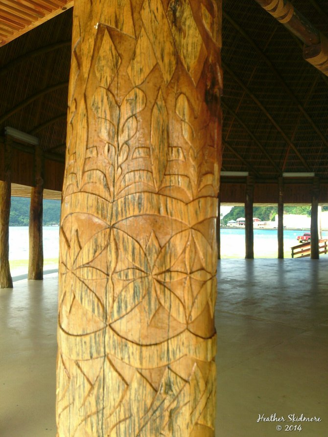 Beautiful wood carvings on a fale in downtown Pago Pago, American Samoa