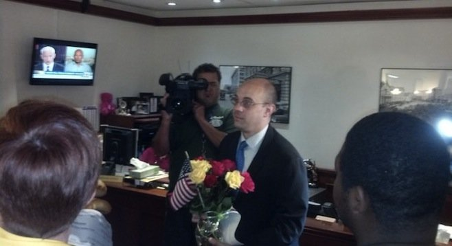 Faulconer staffer Felipe Monroig accepts the delegates' gifts