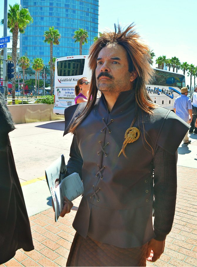 A Comic Con attendee getting into character