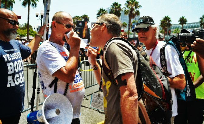 Born-again Christians square off with passersby at Comic Con, in the Gaslamp.