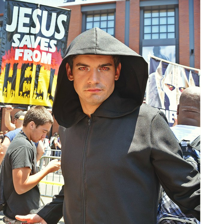Promoting the series Witches of East End, a hooded coven stations itself appropriately by the born again Christians.