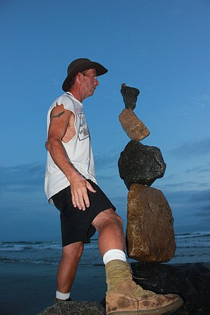 """I would like to introduce to you to Mike, the gentleman who balances rocks with the utmost care on top of one another.  Mike finds the inner balance of each rock and creates these amazing statues anywhere and anytime.  My husband and I met Mike at the Oceanside Pier last month and he was happy to pose for me.  In this photo he had just placed the top rock and I happened to snap this photo within seconds of it.  Amazing huh?   """"it's a Vilma!"""""""