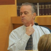 Greg Foley showed the jury how he put the knife to his own throat. Photo by Eva