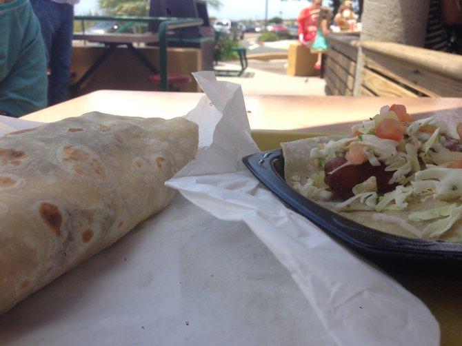Mano a mano, food style. California burrito and fish taco. Roberto's Very Mexican Food.