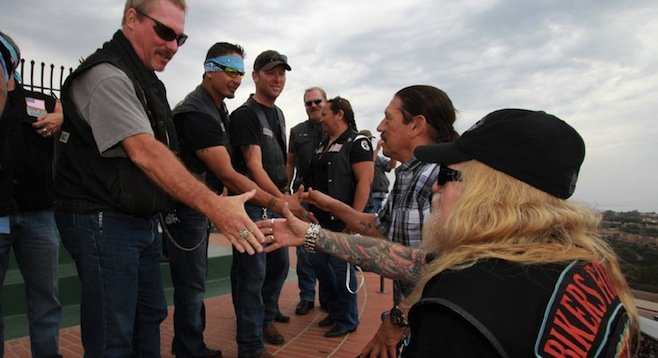 Pastor Z and Danny Trejo were greeted at the top of the stairs by veterans.