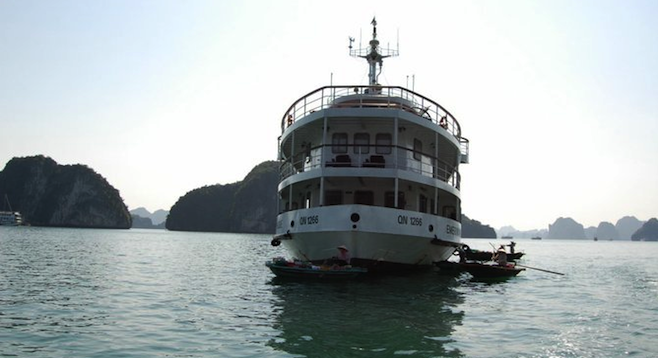 Our vessel, the Emeraude, surrounded by sampans at Halong Bay.