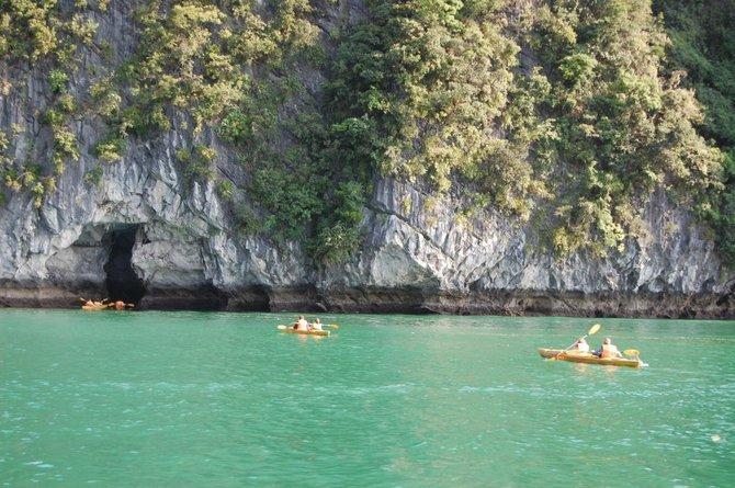 Kayakers explore Halong Bay.