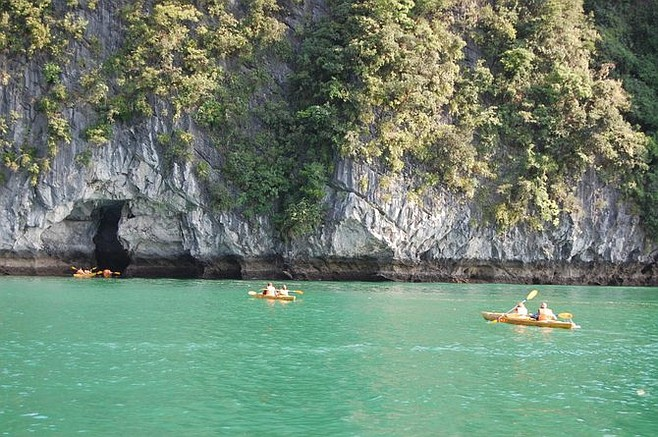 Kayakers explore Halong Bay.