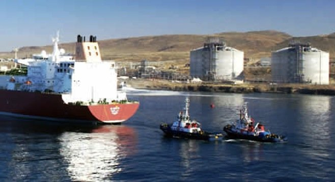 Tugs follow a liquified natural gas carrier as it prepares to dock at Sempra's Baja facility