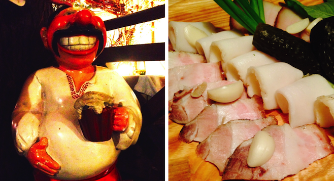 Left: Ukrainian cossack warrior statue greeting visitors entering the restaurant (maybe a retired one?); right: salo: pig fat, up close and personal, with meat, pickles and touches of garlic. Yumm....