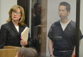 Attorney Kathleen Cannon w defendant Chang. Photo by Weatherston