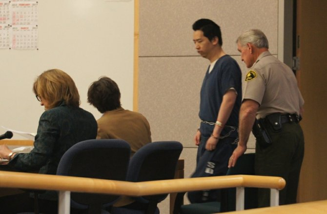 Brian Chang brought into court during a hearing in 2012.