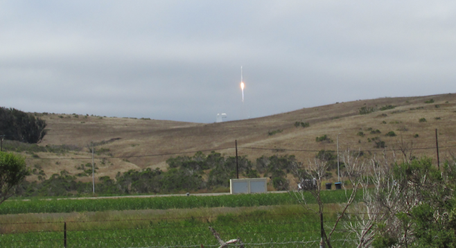 Watching a rocket launch a new satellite into orbit from Vandenberg Air Force Base.