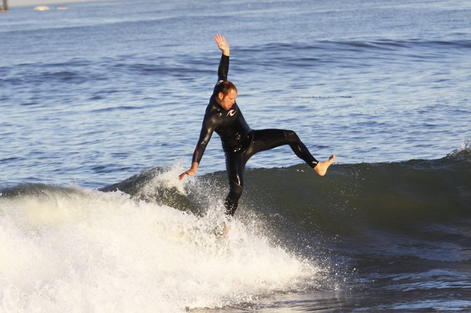 Surfer hanging 20 at Ocean Beach- Ocean Beach, California 92107