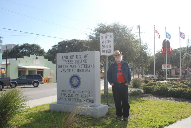 East end of US 80. Note the sign above my head.  The West end is in Ocean Beach, CA. Picture taken in Tybee Island Georgia,  A mid sized beach community, just South of Savannah.