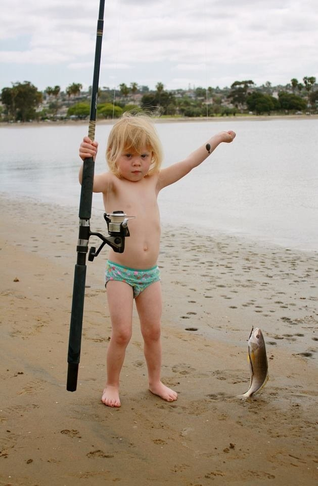 My niece Lucy with her first catch of  fish off Mission Bay using pickle worms as bait.
