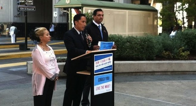 "Todd Gloria, flanked by supporters of his ""Live the Wage Challenge"""