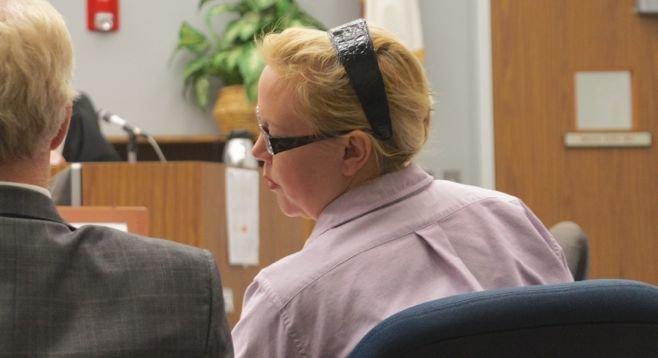 Julie Harper has a word with her defense attorney, Paul Pfingst, September 3, 2014