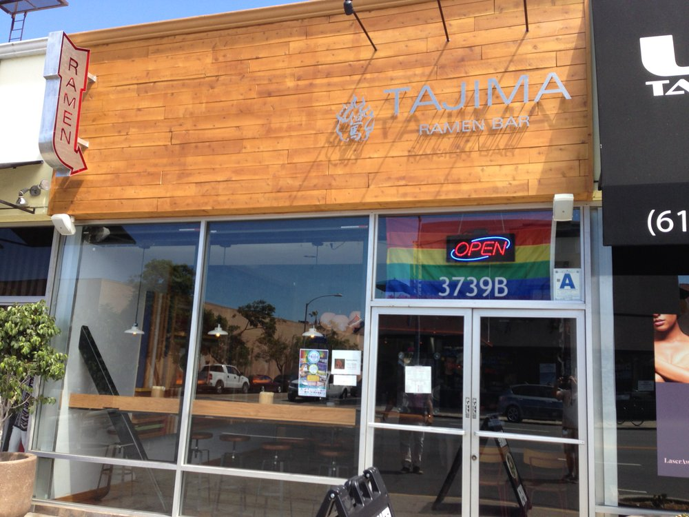 Japanese restaurant with a rainbow flag working here.