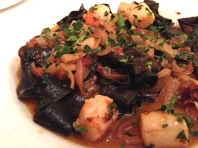 This photo doesn't come close to giving this delectable squid ink papardelle with scallops dish justice.