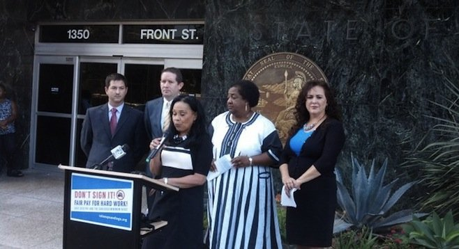 Councilwoman Myrtle Cole, flanked (left) by attorney Will Moore and senator Marty Block representative Chris Ward, and (right) assemblywomen Shirley Weber and Lorena Gonzalez