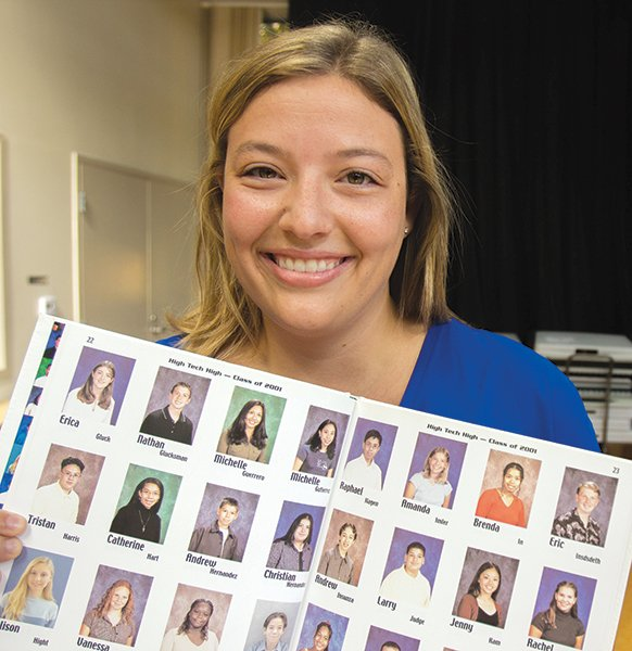 Amanda Cole, showing her high school yearbook photo (top row, third from the right)