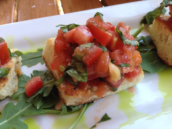 Bruschetta served on soft and delicious housemade focaccia