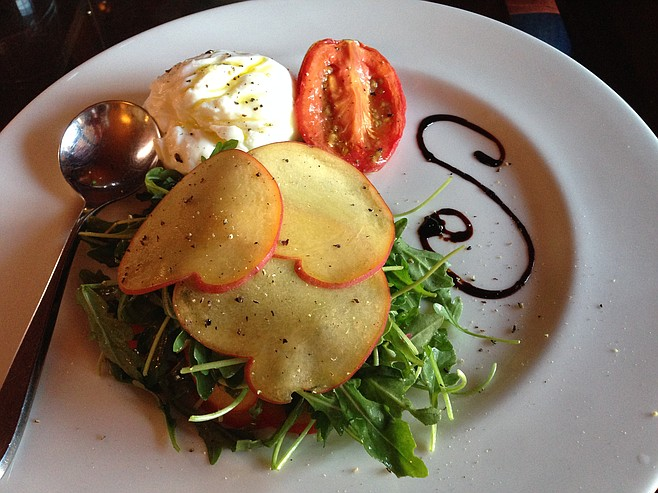 Inventive Caprese salad with burrata, roasted tomato, and thinly sliced peach