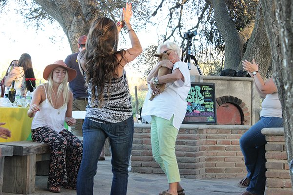 Invigorated on organic wine, our party breaks into outlandish dance