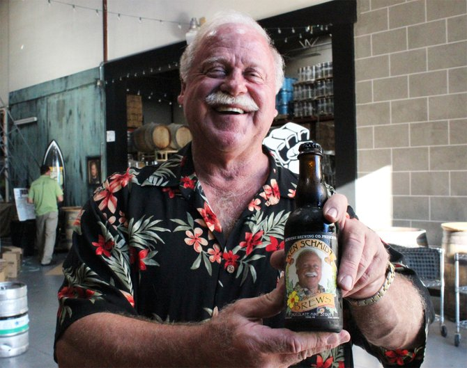 Long-time homebrewer Ken Schmidt poses with his mint chocolate imperial stout, brewed and bottled at Vista's Iron Fist Brewing Company - Image by @sdbeernews