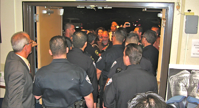 District boardmembers called on police to evict the public from an October 21, 2013, meeting.