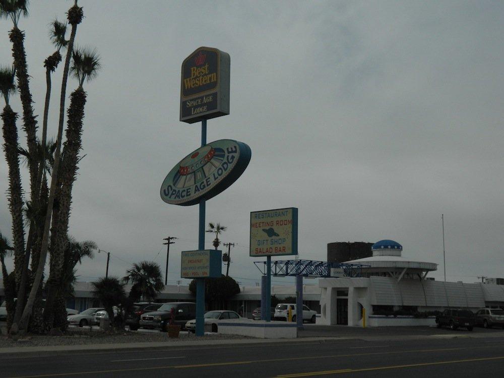 Wacky roadside hotel signage.
