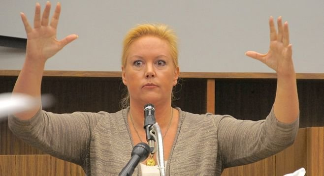 Julie Harper showed the jury how her husband came at her with arms raised.