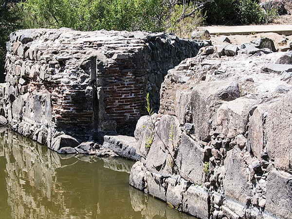 Brick and rock work are visible at the dam site.