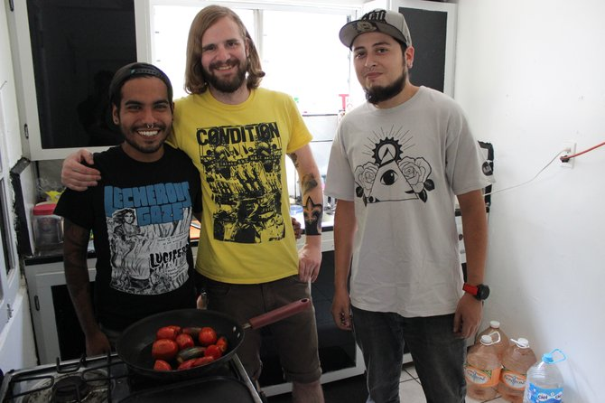 Iván, Boyd, and Danee in the Raíces kitchen.