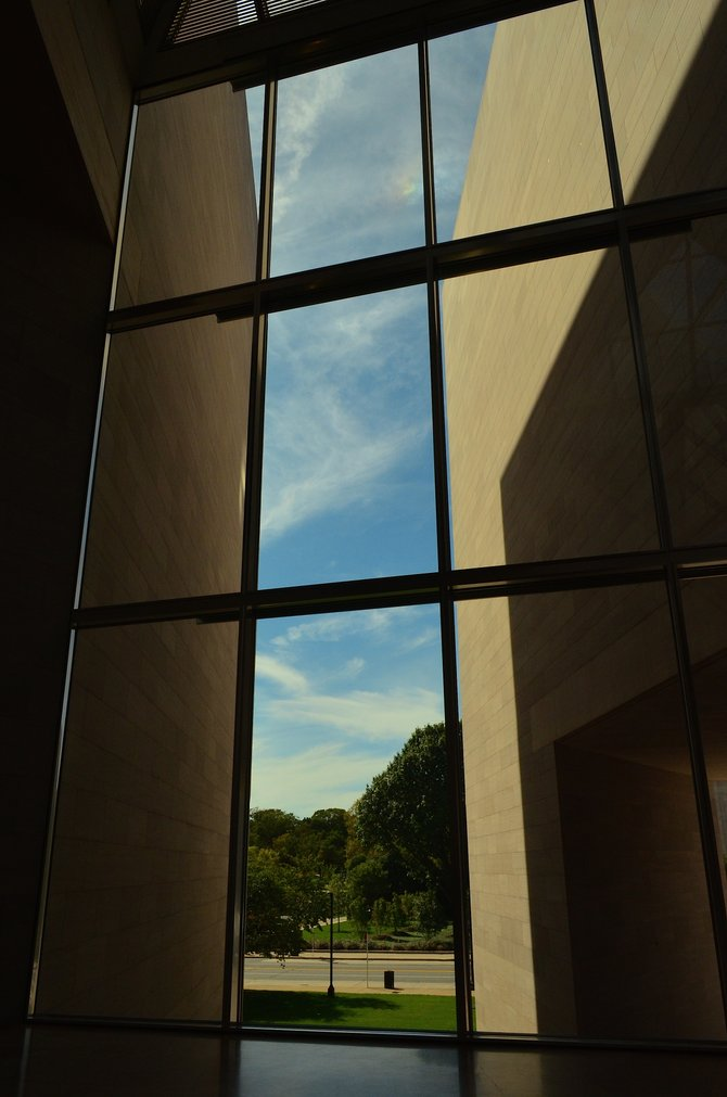 Looking out from inside the East Wing of the National Gallery of Art at The National Mall in Washington DC.  The outside walls of this building are so thin and the lines so straight everything in front of me looks like some kind of mirrored reflection.  September 2014.