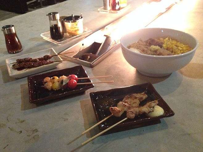 Chicken liver, heirloom tomato and pork belly yakitori, plus miso ramen. Underbelly.