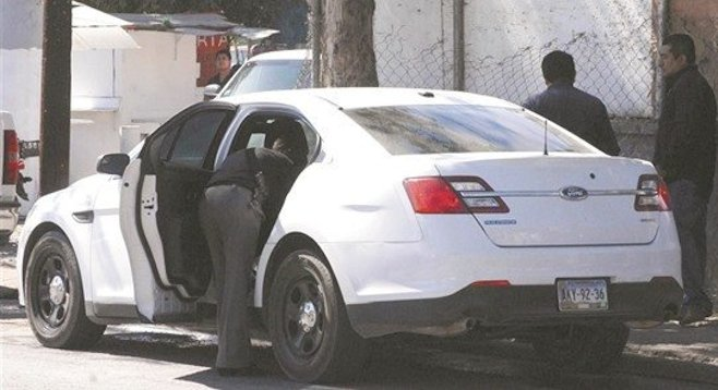 Police investigate their recovered car