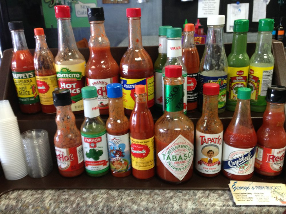 A parade of hot sauce to spice your fish.