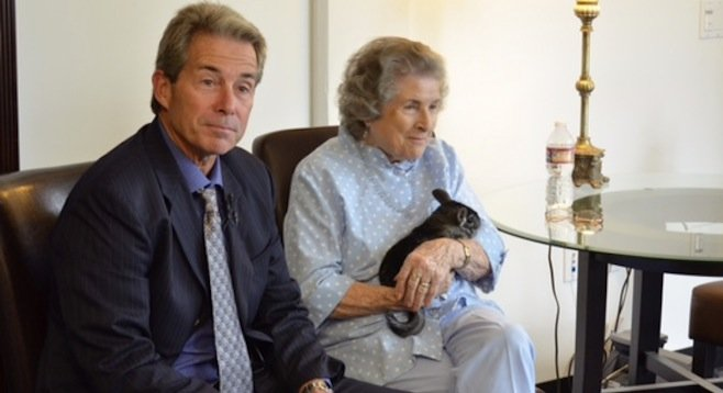 Attorney Michael Curran and Lurlie Adams, holding a chinchilla